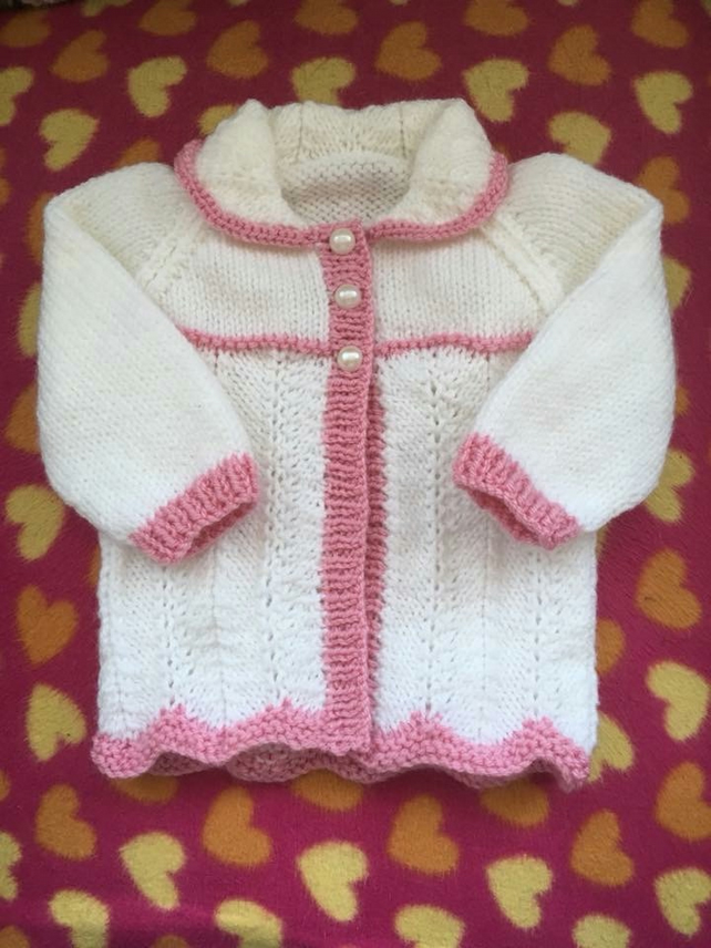 Hand knitted longer length cardigan to fit 0-3 months old baby girl