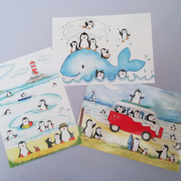 Set of three penguin postcards, seaside, whale and camper van design