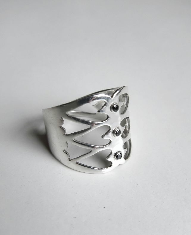 Adjustable silver ring with a heart pattern