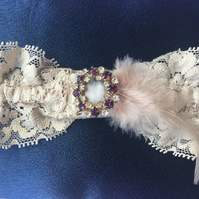 Wedding garter with purple and diamante stones with feather detailing