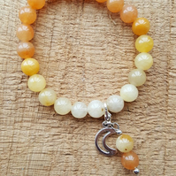 Yellow jade and orange aventurine ombre effect stretch beaded charm bracelet