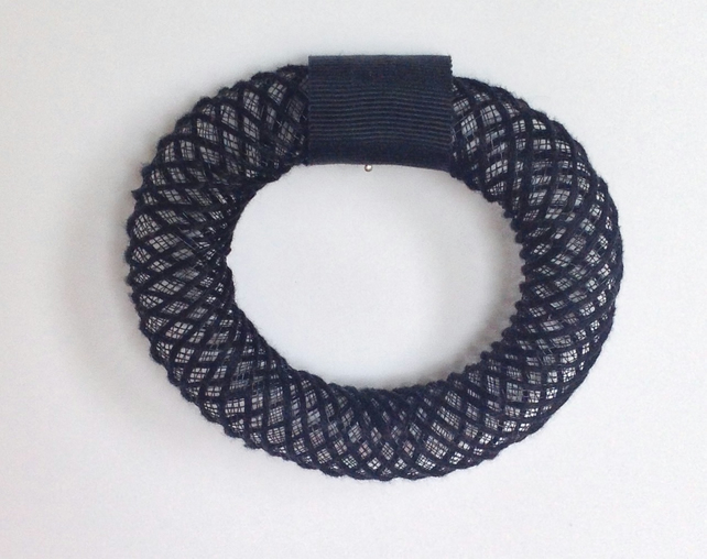 Hand embroidered mesh bangle.