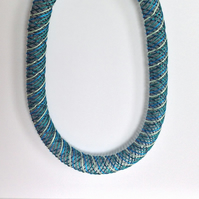Hand embroidered mesh necklace.