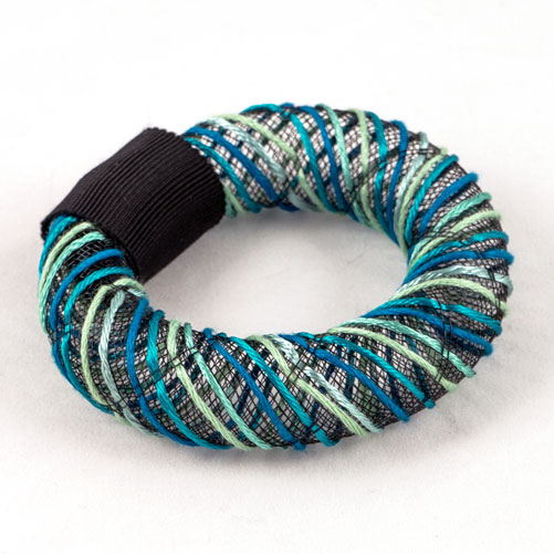 Turquoise hand embroidered mesh bangle.