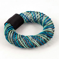 Turquoise embroidered bangle.