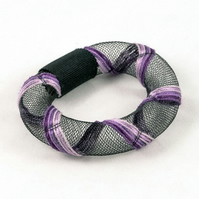 Purple embroidered bangle.