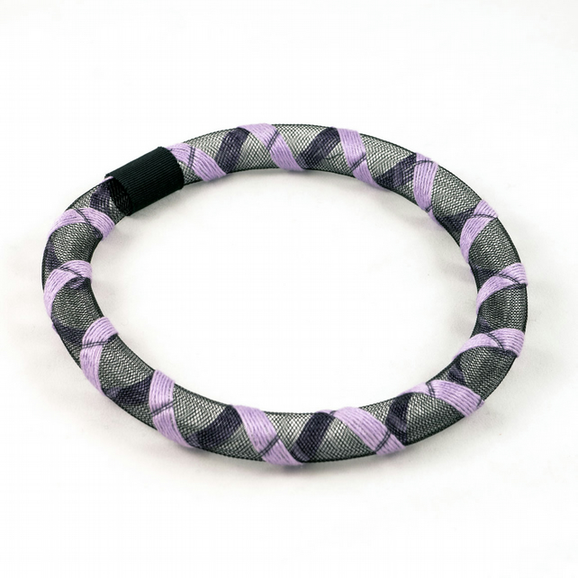 Lilac textile necklace.