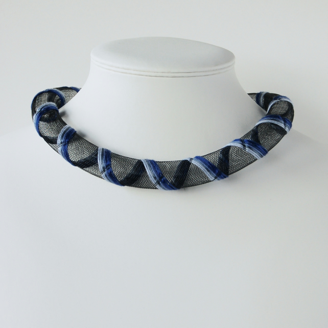 Blue hand embroidered mesh necklace.