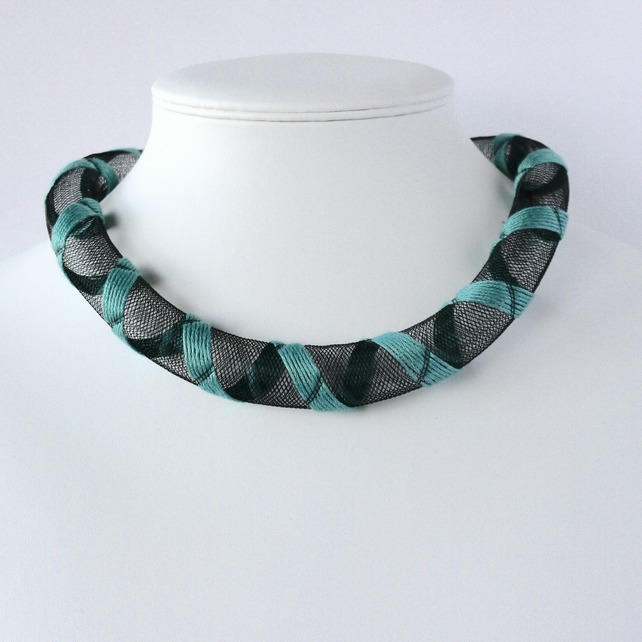 Turquoise embroidered necklace.