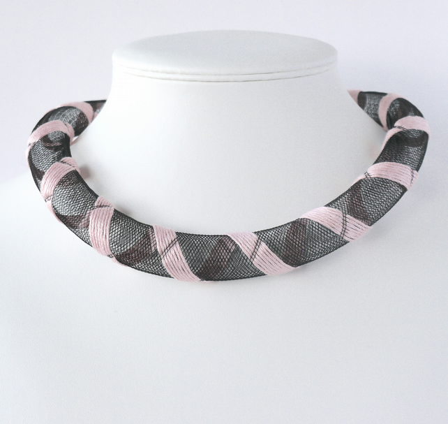 Pale pink embroidered necklace.