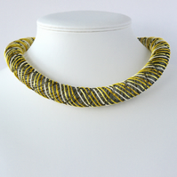 Yellow embroidered necklace.