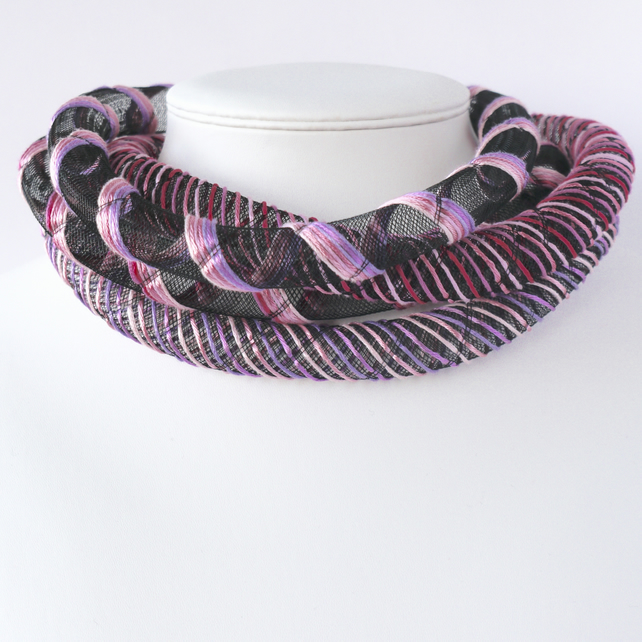Contemporary pink embroidered necklace.