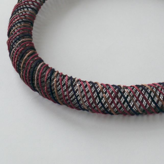 Raspberry pink and purple textile necklace.