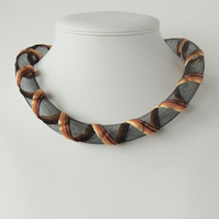 Yellow, orange and brown embroidered necklace.