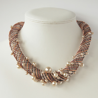 Embroidered peach colour necklace with vintage faux pearls.