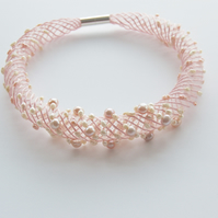 Contemporary embroidered necklace with pearls.