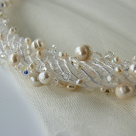 Contemporary necklace with pearl and crystal beads.