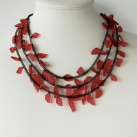 Contemporary red perspex and black necklace.