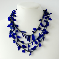 Blue beaded contemporary multi strand necklace.