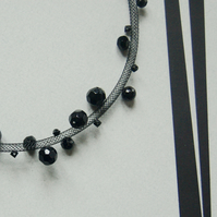 Black faceted bead mesh necklace.