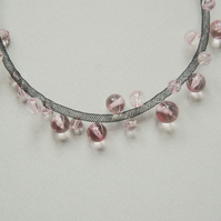 Pink and black bead mesh necklace.