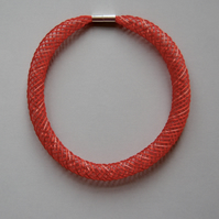 Red hand embroidered mesh necklace.