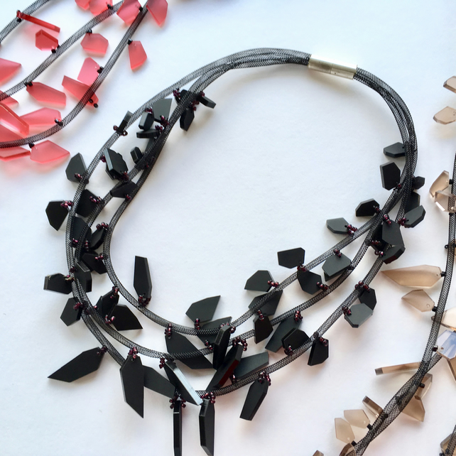 Multistrand black acrylic bead necklace.