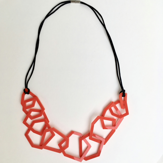 Red geometric acrylic necklace.