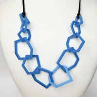 Contemporary blue geometric perspex necklace.