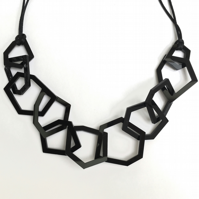 Contemporary black geometric acrylic necklace.