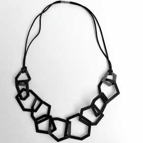 Statement black acrylic contemporary necklace.