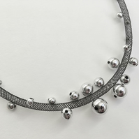 Black mesh and silver bead necklace.