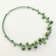 Contemporary green bead necklace.