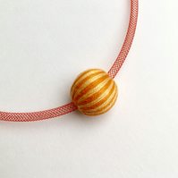 Contemporary yellow and orange bead necklace.