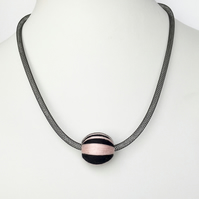 Contemporary black and pink mesh necklace.