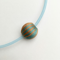 Modern turquoise and old gold striped bead necklace.