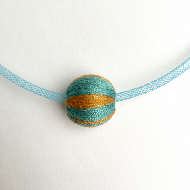 Modern design blue mesh necklace with striped bead.