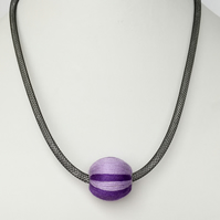 Modern purple and lilac bead necklace.