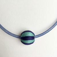 Contemporary navy blue bead necklace.