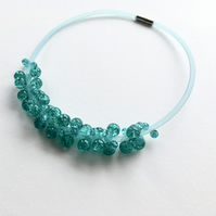 Aquamarine crackled glass bead mesh necklace.