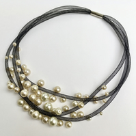 Black faux pearl three strand mesh necklace.