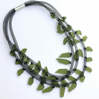 Contemporary three strand green acrylic black mesh necklace.