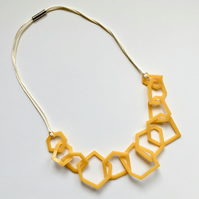 Yellow acrylic geometric necklace.