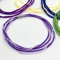 Purple and lilac three strand mesh and cord necklace.