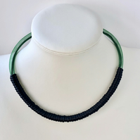 Modern green and black wrapped single strand necklace.