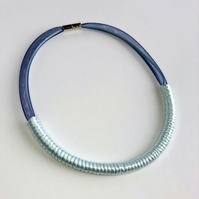 Contemporary pale blue cord necklace.