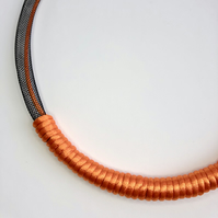 Orange and black cord mesh tube necklace.