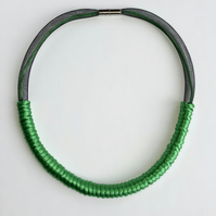 Emerald green and black cord necklace.