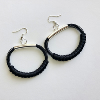 Contemporary design black mesh and cord pendant earrings.