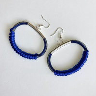 Blue circular pendant modern earrings.
